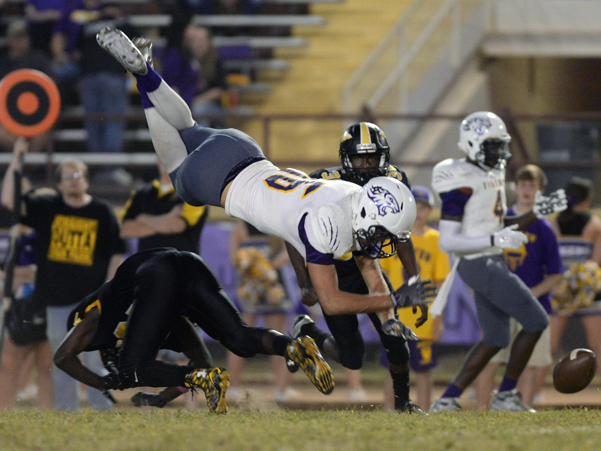 Fair Park's Latrevione Davis upends John Westmoreland of Benton, breaking up a pass attempt in the first quarter of their game on Thursday night at BTW. Benton won 42-22.