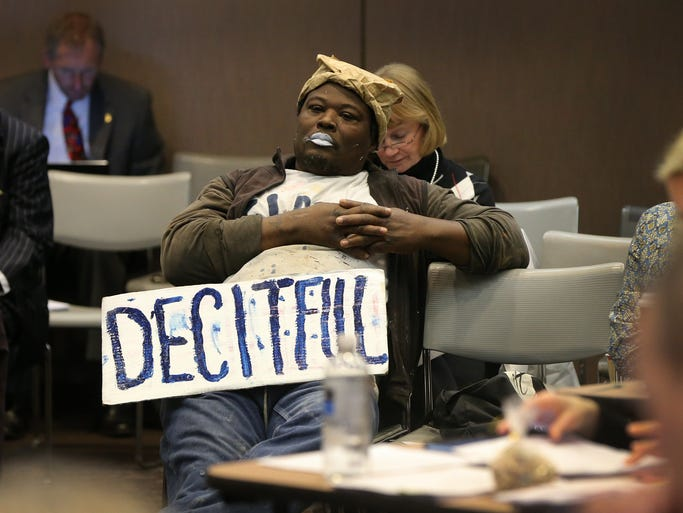 A frequent protester sits in the audience and listens to the  board members meeting during the State Board of Education meeting Friday morning at the Indiana Government Center.