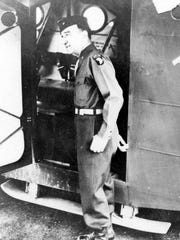 "Brig. Gen. Don F. Pratt poses in the door of the ""Fighting Falcon"" on the eve of the Normandy invasion in June 1944."