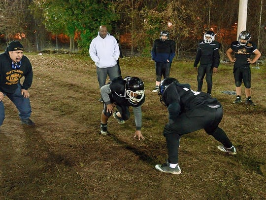 Paterson Nifty Lions coach Steven Ponce, left, works with his team in preparation for the upcoming regional championship game  Chris Monroe/ Special to NorthJersey.com