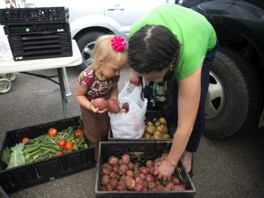 Annie Nelson and AnneMarie Nelson pick out potatoes