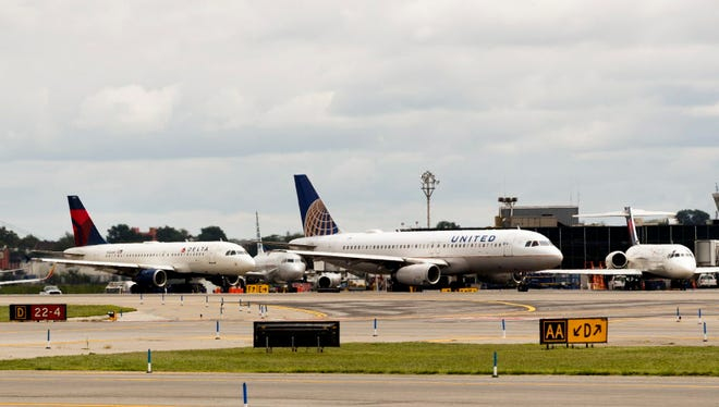 Planes line up for take off at LaGuardia Airport in East Elmhurst, N.Y., on Aug. 8, 2017.