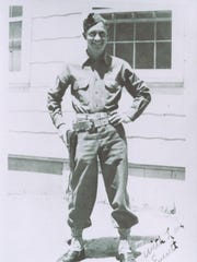 Pvt. Everett Griffin of Barton with his side arm at