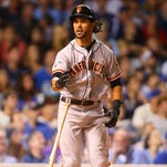 Giants center fielder Angel Pagan reacts after hitting
