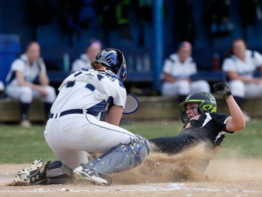 Pawling's Ali Parent slides into Pine Plains' catcher