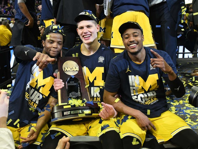 Michigan players (from left) Zavier Simpson, Moritz