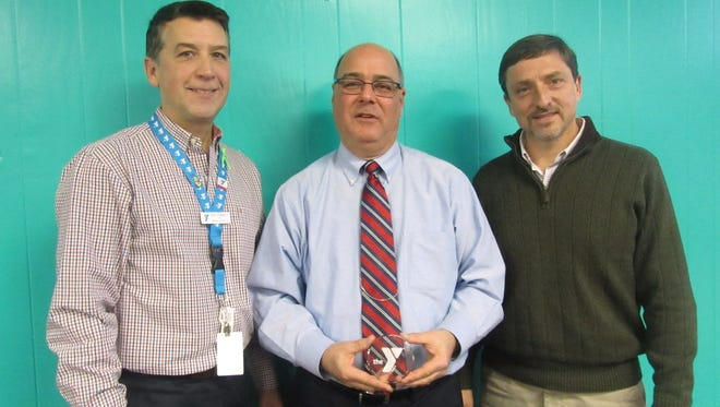 George Steinbronn Jr. (left), chief executive officer of the YMCA of Vineland, and John Barretta (right), YMCA board president, honor David Schad, who recently retired from the board after serving for 16 years.