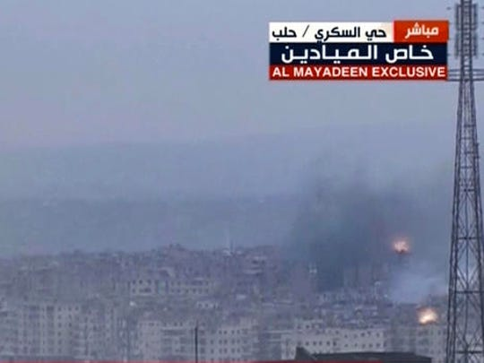 This frame grab from video provided by the Beirut-based pan-Arab satellite channel Al Mayadeen, which is close to the Syrian government, broadcast on Wednesday, Dec. 14, 2016, shows explosions followed by plumes of smoke, in East Aleppo, Syria. A cease-fire deal between rebels and the Syrian government in the city of Aleppo has effectively collapsed with fighter jets resuming their devastating air raids over the opposition's densely crowded enclave in the east of the city. The attacks threaten plans to evacuate the rebels and tens of thousands of civilians out of harm's way, in what would seal the opposition's surrender of the city.
