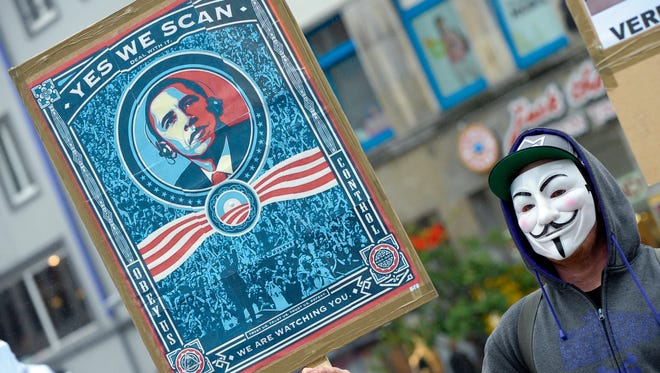 A demonstrator in Hanover, Germany, protests the U.S spying programs in June.