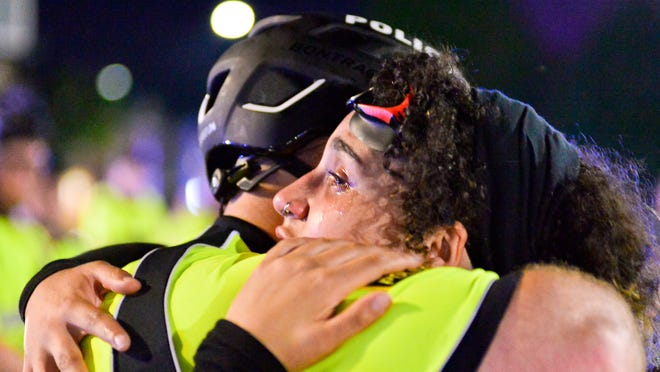 Taunton Police Officer Harrison McNeil hugs a crying protester during Thursday night's protest on the Taunton Green on June, 4, 2020.  Taunton Gazette photo | Mike Borden