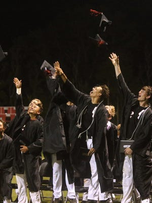 Eleven seniors on the Stewarts Creek baseball team toss their hats after a small graduation ceremony following a regional game against Blackman on Wednesday, May 17, 2017.