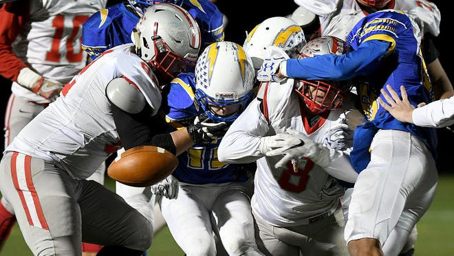 Shelby's Devon Brooks fumbles the ball Friday night during the playoff game with Philo at Westerville North High School.