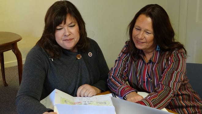 Dr. Cynthia Bettison, Director of the Western New Mexico University Museum, at left, reviews a grant proposal with Lisa Jimenez, Manager of Curbside Consulting.