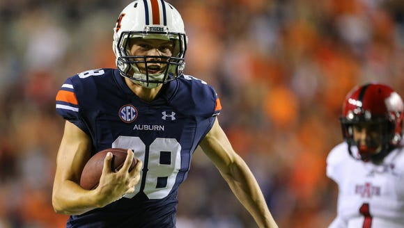 Auburn kicker Daniel Carlson (38) carries the ball