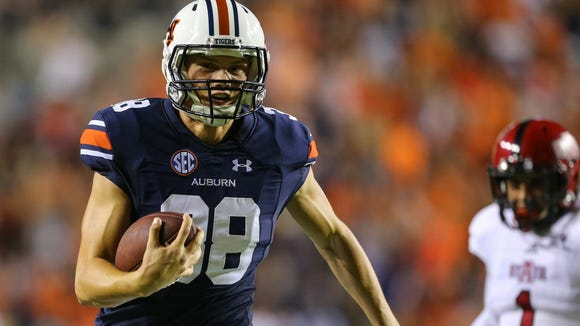 Auburn kicker Daniel Carlson (38) carries the ball in for a touchdown on a fake field goal during the first half of an NCAA college football game against Arkansas State, Saturday, Sept. 10, 2016, in Auburn, Ala.