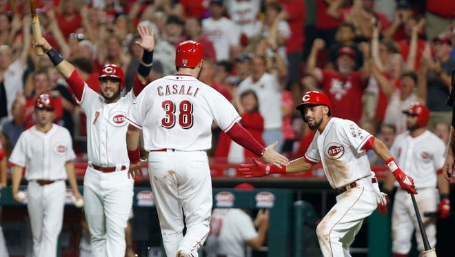 Aug 11, 2018; Cincinnati, OH, USA; Cincinnati Reds catcher Curt Casali (38) is congratulated by Cincinnati Reds center fielder Billy Hamilton (6) after scoring against the Arizona Diamondbacks during the eighth inning at Great American Ball Park. Mandatory Credit: David Kohl-USA TODAY Sports