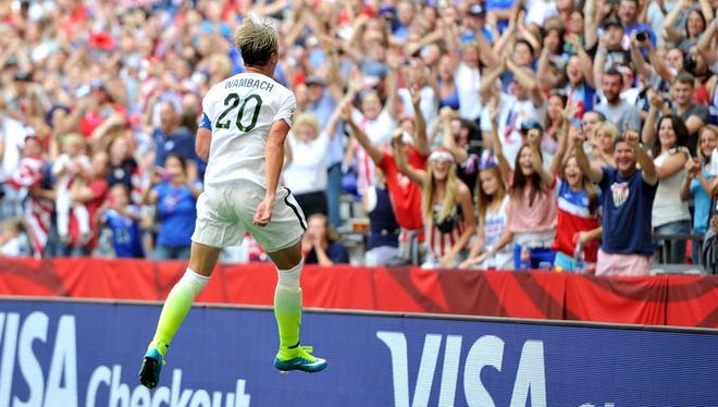 Abby Wambach of the U.S. celebrates scoring a goal in the first half against Nigeria at BC Place Stadium