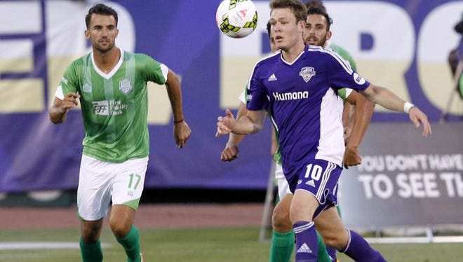 Louisville FC's Magnus Rasmussen (10) battles pressure from OKC Energy FC's Daniel Gonzalez (12) during their game at Louisville Slugger Field in Louisville, Kentucky. June 27, 2015