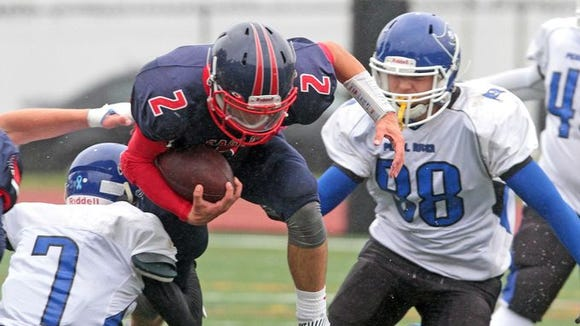 Eastchester quarterback John Arcidiacono is upended by Pearl River's Kyle Murphy during a varsity football game at Eastchester High School Oct. 3, 2015. Eastchester cruised to a 31-7 victory over Pearl River.