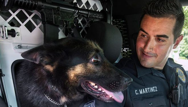 Sgt. Chris Martinez with Tazer in a Ford Explorer designed for K-9 duty at the Newberry Township Police Department July 14, 2015. Both Martinez and Tazer were involved in a crash in Newberry Township Jan. 3, 2015.