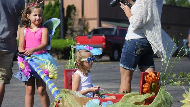 Participants wait for ice cream tokens during the Clearwater Heritage Days kiddie parade in 2015.