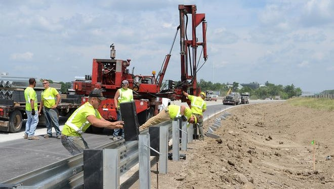 Crews work on the I-275 construction project earlier this summer.