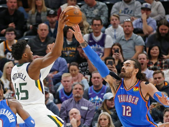Oklahoma City Thunder center Steven Adams (12) defends against6 Utah Jazz guard Donovan Mitchell (45) in the first half of an NBA basketball game Monday, Dec. 9, 2019, in Salt Lake City. (AP Photo/Rick Bowmer)