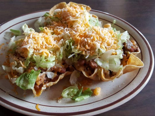 Tostadas compuestas ($8.50) comes with three tostadas filled with green chile, stew meat, whole beans and cheese