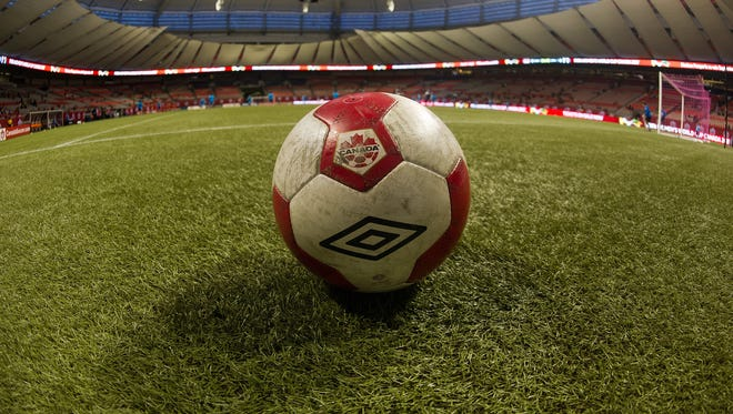 A soccer ball sits on the artificial turf at BC Place Stadium ready for Women's International Soccer Friendly Series action between Japan and Canada on October 28, 2014 at BC Place Stadium in Vancouver.