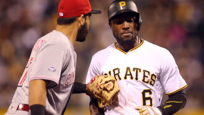 Cincinnati Reds third baseman Eugenio Suarez tags out Pittsburgh Pirates left fielder Starling Marte (6) in a run-down during the sixth inning at PNC Park.