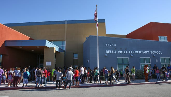 Students and parents line up for the first day of school at Bella Vista Elementary in Desert Hot Springs, August 9, 2017.