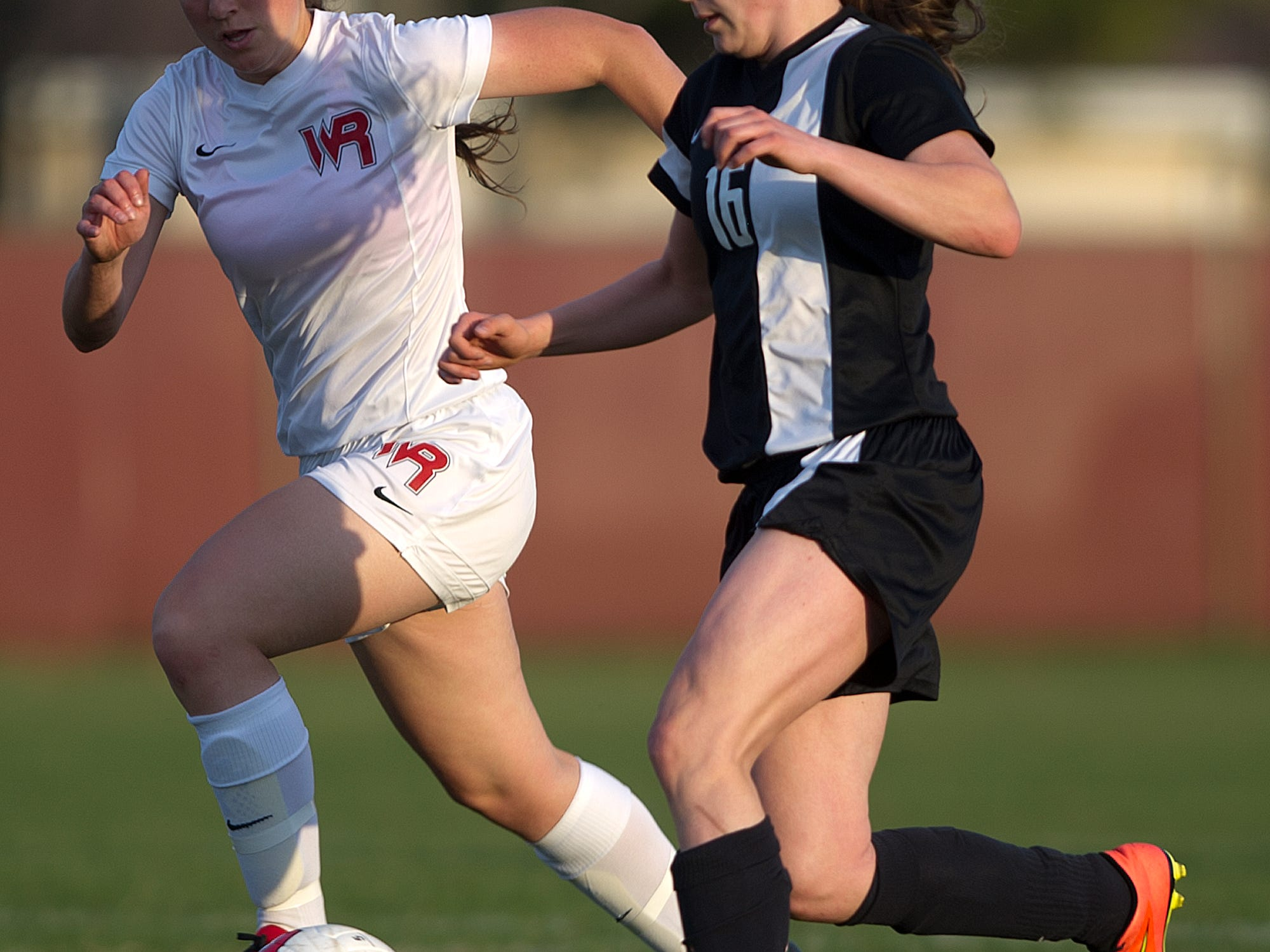 Wisconsin Rapids' Katie Kiiskila, left, challenges Stevens Point Area Senior High's Autum Shurbert-Hetzel, right, during a Wisconsin Valley Conference soccer game Tuesday at Washington Field in Wisconsin Rapids.