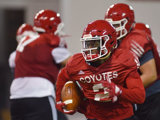 USD's Kai Henry runs drills during practice after media day Thursday, Aug 9, at the DakotaDome in Vermillion.