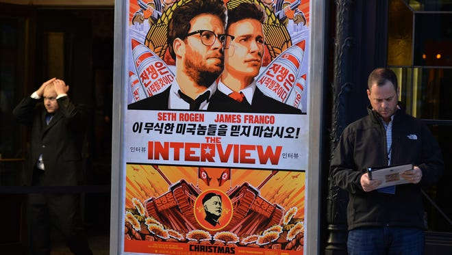 """In this December 11, 2014 photo, security is seen outside The Theatre at Ace Hotel before the premiere of the film """"The Interview""""  in Los Angeles, Calif."""