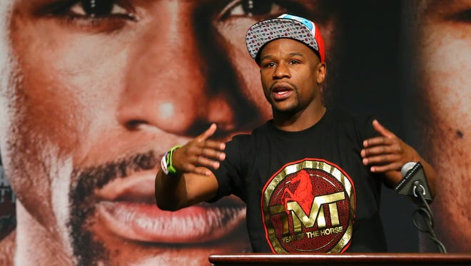WBC welterweight champion Floyd Mayweather speaks at the press conference Saturday at the MGM Grand.