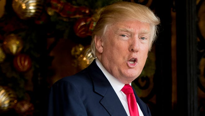 In this Dec. 21, 2016, file photo, President-elect Donald Trump speaks to members of the media at Mar-a-Lago, in Palm Beach, Fla.