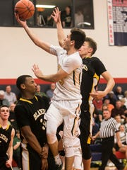 York Catholic's Kyle Derowski (3) gets called for a charge as he goes up for the shot against Lancaster Mennonite's Javan Terry (34) during the first  OT in a District 3 Class 3-A semifinal game Thursday at Red Land High School. York Catholic, lost 64-63. Amanda J. Cain photo