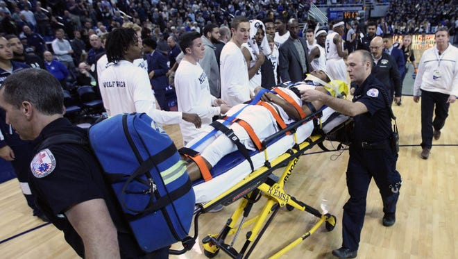Nevada guard Josh Hall is taken off the court after a hard collision with San Jose State forward Brandon Mitchell on Wednesday.