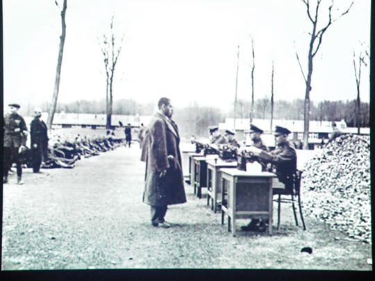 As photographed during Harold Gordon's presentation on Tuesday, incoming prisoners register with concentration camp authorities at Buchenwald.