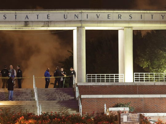 Officials investigate the scene of a shooting on the campus of Tennessee State University, early Friday, Oct. 23, 2015, in Nashville, Tenn. Authorities say one person was killed and two others hospitalized in the Thursday shooting at an outdoor courtyard. A campus spokesperson said the person killed wasn't enrolled at the school. (AP Photo/Mark Humphrey)