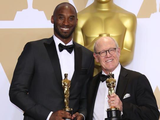 Kobe Bryant, left, and Glen Keane, winners of the award