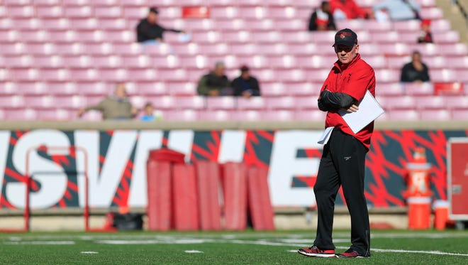 "Louisville head coach Bobby Petrino during Spring scrimmage Saturday. ""Last part of the scrimmage was really about toughness,"" Petrino said. ""We try to run the ball every snap and let our players understand that, at some point in the fourth quarter, you're going to have to run the ball to win, or stop it to win.""  By Matt Stone, The C-J April 11, 2015."