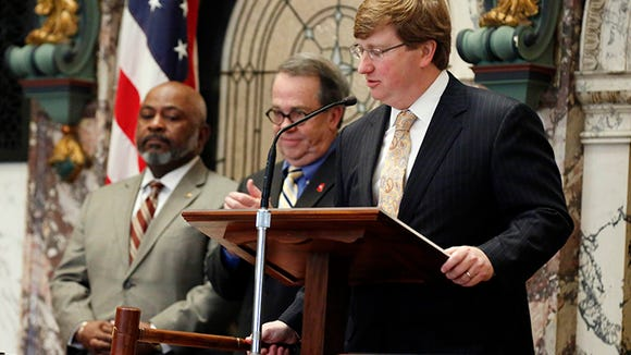Mississippi Lt. Gov. Tate Reeves, right, drops the gavel ending its part of the 2015 legislative session, Wednesday April 1, 2015 at the Capitol in Jackson, Miss. However, the House will be back Thursday for one more day as they deal with several recommitted bills.