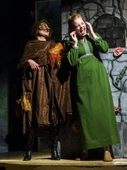 "Krystine Scolley, left, and Courtney Tank, right, act out a scene as the Witch and Rapunzel during the ""Into the Woods"" dress rehearsal Tuesday."