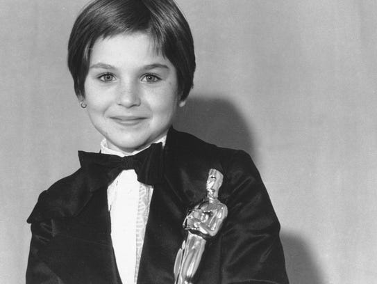 Tatum O'Neal holds her Oscar statuette at the 46th