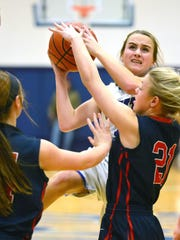 White House High sophomore guard McKenzie Vaughn elevates