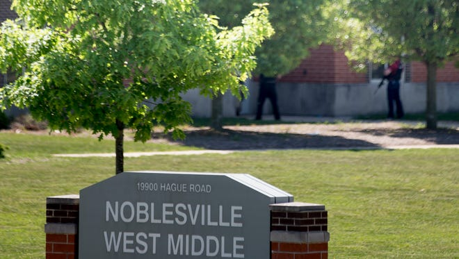 A large law enforcement presence (barely visible in background), outside a shooting at or near Noblesville West Middle School, Noblesville, Friday, May 25, 2018. One person is reportedly in custody.