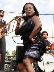 FILE - In this June 14, 2008 file photo, Sharon Jones and the Dap-Kings perform at the Bonnaroo music festival in Manchester, Tenn. Jones, a big-voiced soul singer who performed with high energy onstage has died at age 60 in New York, after battling pancreatic cancer. Her representative Judy Miller Silverman says she died Friday, Nov. 18, 2016, at a Cooperstown hospital surrounded by her band, the Dap-Kings.