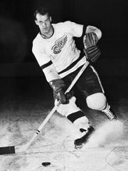 "FILE - This 1956 file photo shows Detroit Red Wings hockey player Gordie Howe. Howe, the hockey great who set scoring records that stood for decades, has died. He was 88. Son Murray Howe confirmed the death Friday, June 10, 2016, texting to The Associated Press: ""Mr Hockey left peacefully, beautifully, and w no regrets."""