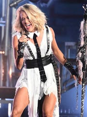 FILE - In this Wednesday, Nov. 2, 2016, file photo, Carrie Underwood performs at the 50th annual CMA Awards at the Bridgestone Arena in Nashville, Tenn. John Legend, Underwood, Keith Urban and Metallica are set to perform at the Grammy Awards on Feb. 12, 2017. (Photo by Charles Sykes/Invision/AP, File)